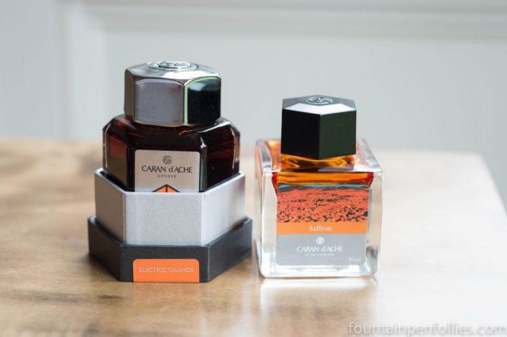 Caran d'Ache Electric Orange and Caran d'Ache Saffron ink bottles
