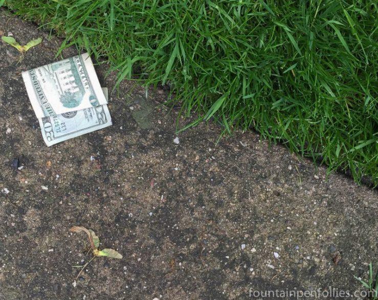 Twenty Dollar bill on sidewalk
