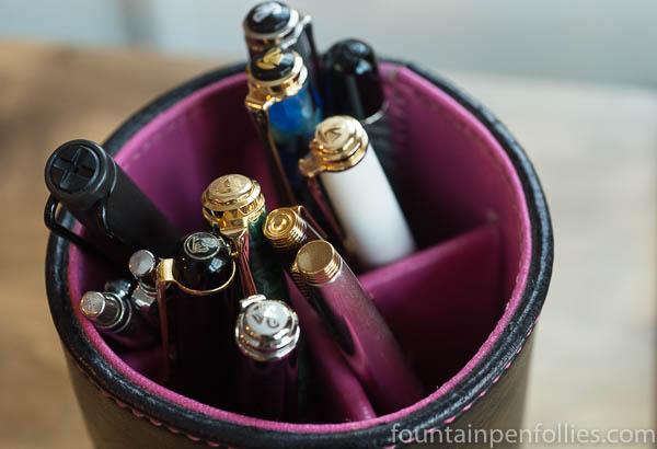 pens in pen cup